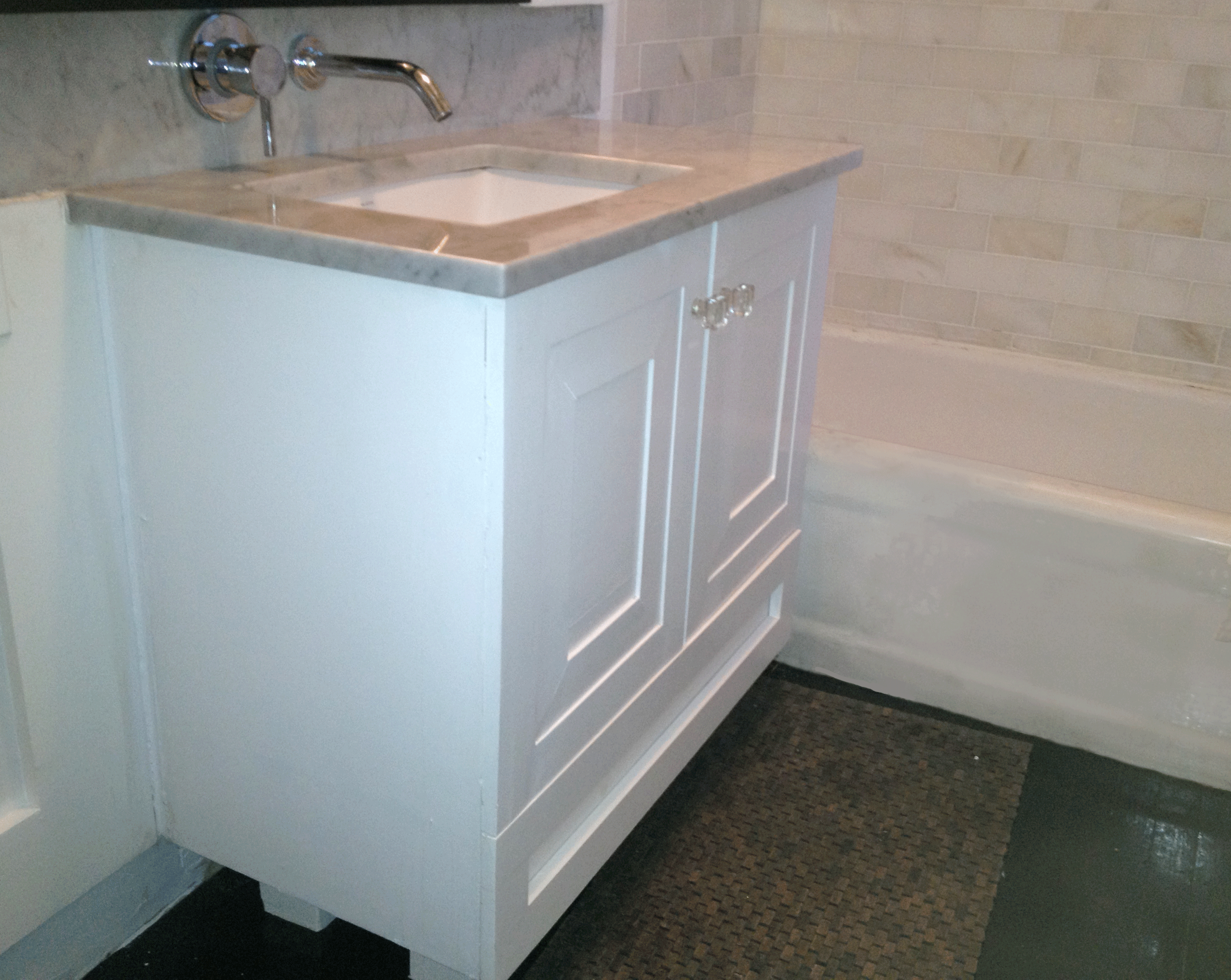 Brooklyn Custom made Bathroom vanity with custom molding and bottom drawer with dividers